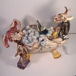 Rabbits taking a bubble bath by Heather Goldminc
